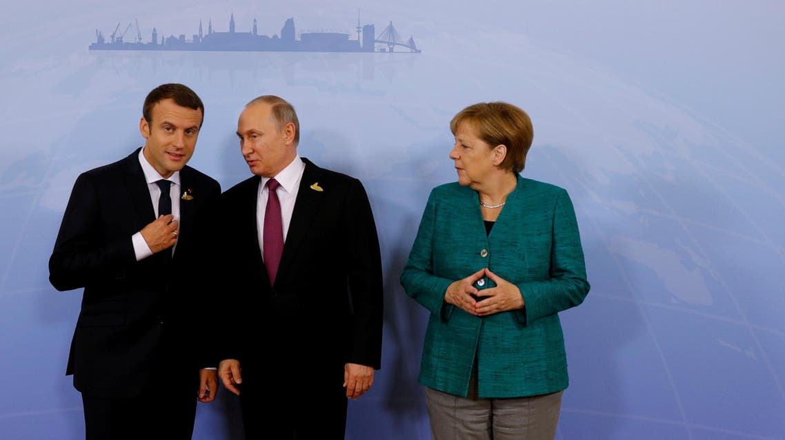 German Chancellor Angela Merkel, Russian President Vladimir Putin and French President Emmanuel Macron meet during the G20 leaders summit in Hamburg, Germany July 8, 2017. (Reuters)