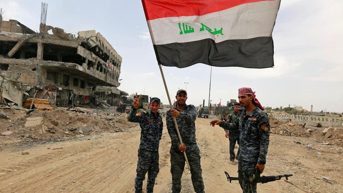 Iraqi Federal Police celebrate in the Old City of Mosul, Iraq July 8, 2017.