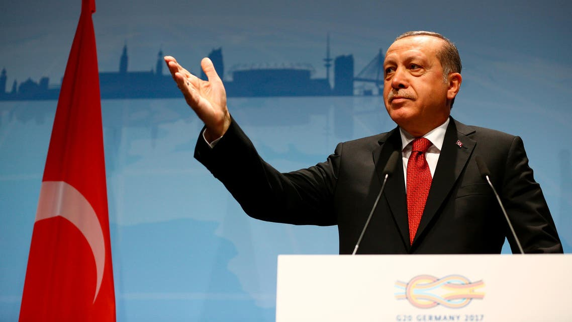 Turkish President Recep Tayyip Erdogan gestures during a news conference to present the outcome of the G20 leaders summit in Hamburg, Germany July 8, 2017