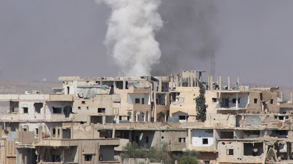 Smoke rises after shelling on a rebel-held part of the southern city of Deraa, Syria June 22, 2017. REUTERS/Alaa Al-Faqir