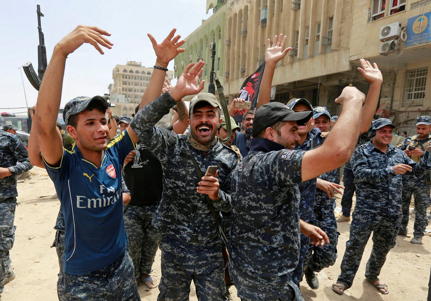 Iraqi Federal Police celebrate in the Old City of Mosul, Iraq, on July 8, 2017. (Reuters)