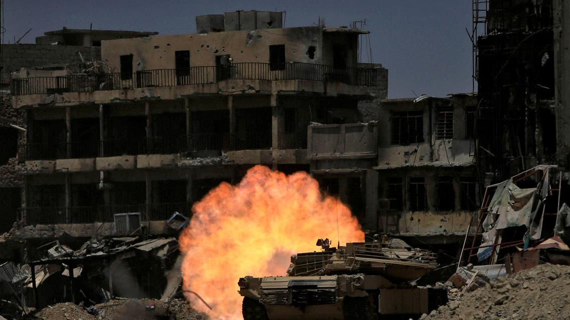 A tank of the Emergency Response Division fires at ISIS militant in the old city of Mosul, Iraq July 5, 2017. (Reuters)