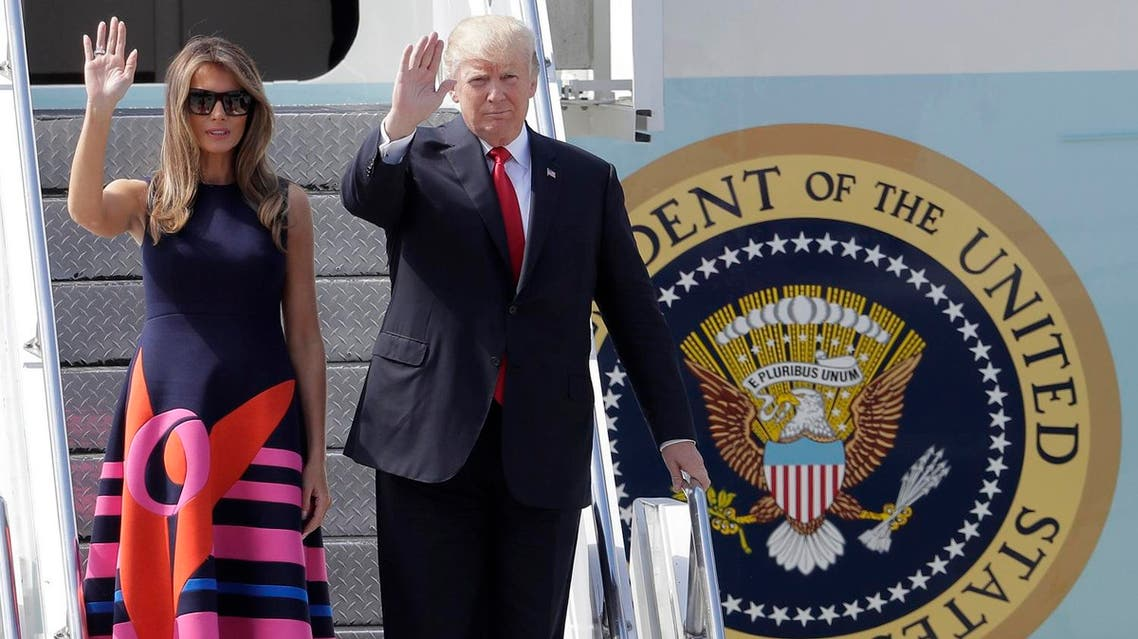 U.S. President Donald Trump and his wife Melania, left, wave, after arriving for the G-20 summit in Hamburg, northern Germany, Thursday, July 6, 2017. The leaders of the group of 20 meet July 7 and 8. (AP