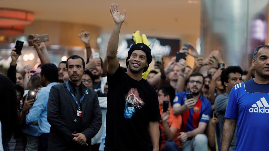 Brazilian soccer star Ronaldinho waves at his fans, as he arrives for a show game, at a mall, as part of the 67th FIFA Congress in Manama, Bahrain May 09, 2017. (Reuters)