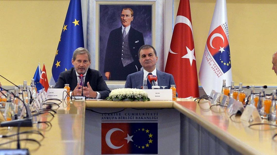 European Commissioner for Enlargement Johannes Hahn (L) and Turkish EU Affairs Minister Omer Celik (R) attend a meeting to discuss Turkey's European Union membership bid on July 6, 2017, in Ankara. (AFP)