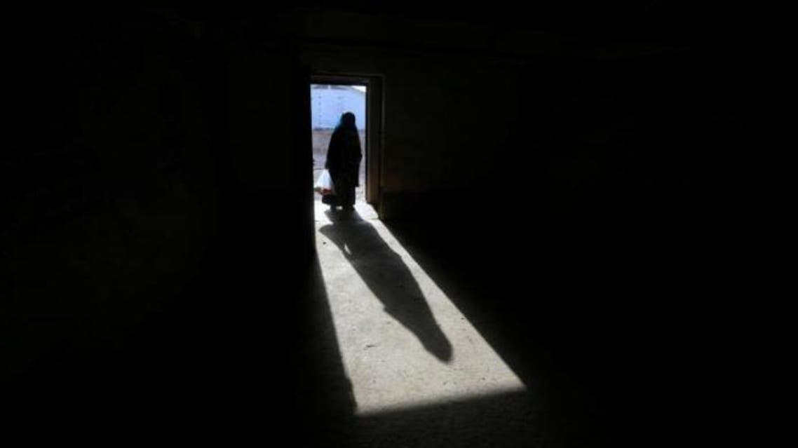 The shadow of a displaced old woman is seen in Hassan Sham camp, east of Mosul, Iraq July 7,2017. REUTERS/ Alaa Al-Marjani