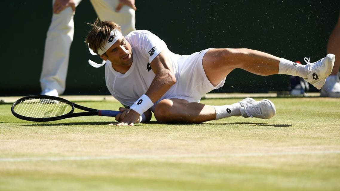 Spain's David Ferrer after falling during his third round match against Czech Republic's Tomas Berdych. (Reuters)