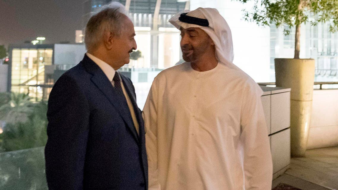 Abu Dhabi Crown Prince and Deputy Supreme Commander of the UAE Armed Forces Mohammed bin Zayed al-Nahyan (R) posing for a photograph with Libya's Khalifa Haftar. 9AFP)