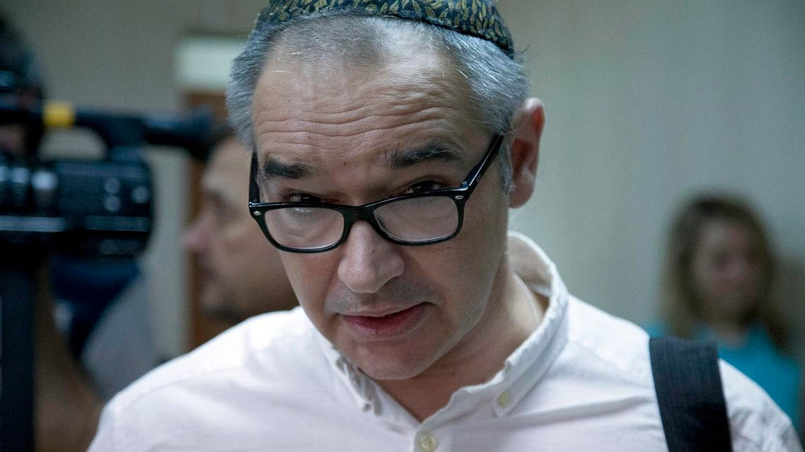 Anton Nosik stands at a court room in Moscow, Russia, Wednesday, Aug. 3, 2016. Hearings started on Wednesday in the case of Russian blogger Anton Nosik, who is charged with extremism. The blogger is currently under house arrests for his post on Syria in Live journal called 'Wipe Syria off the face of the earth' in which he compared Russian to Nazi Germany. (AP Photo/Ivan Sekretarev)