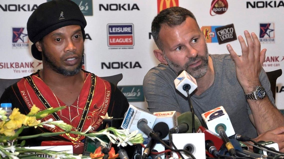 Manchester United legend Ryan Giggs (right), speaks next to Brazilian soccer star Ronaldinho, during a press conference in Lahore, Pakistan, Sunday, July 9, 2017. Ronaldinho and Giggs were among the soccer stars that arrived in Pakistan to play exhibition matches. (AP)