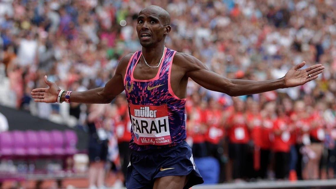 Great Britain's Mo Farah celebrates winning the Men's 3000m. (Reuters)