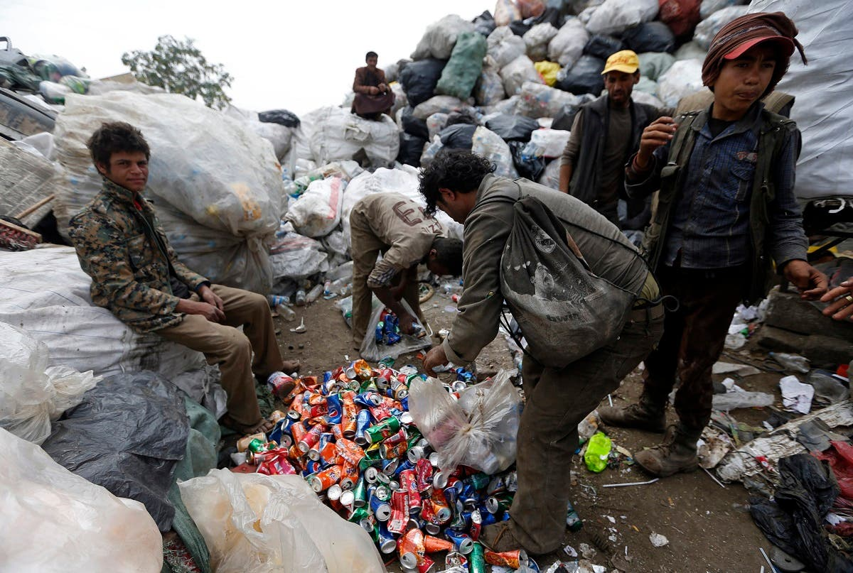Yemeni men scavenge for recyclable items at a garbage dump on the outskirts of Sanaa. (AFP)