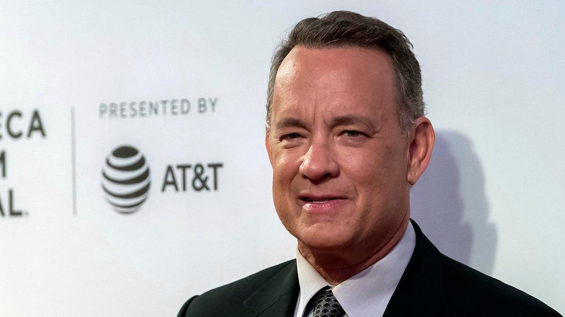 """FILE - In this April 26, 2017 file photo, Tom Hanks attends """"The Circle"""" premiere during the 2017 Tribeca Film Festival in New York. Hanks is on the beat in New York City, using Twitter Saturday, May 20, 2017, to alert police to a car with a slew of tickets on its windshield. Turns out the tickets were paid. (Photo by Charles Sykes/Invision/AP, File)"""