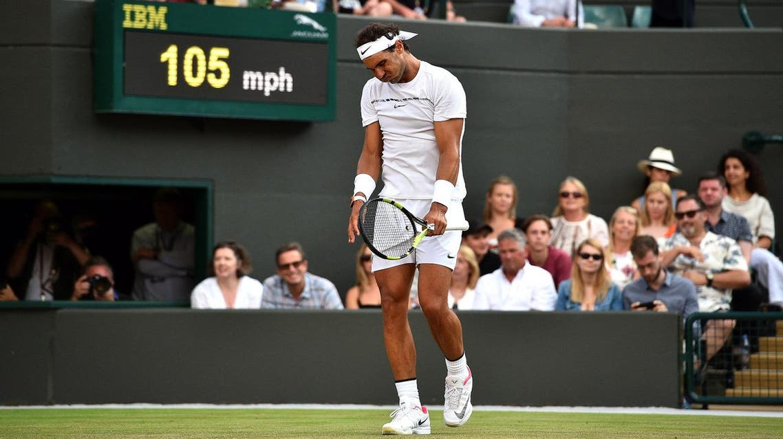 Spain's Rafael Nadal reacts against Luxembourg's Gilles Muller during their men's singles fourth round match on the seventh day of the 2017 Wimbledon Championships at The All England Lawn Tennis Club in Wimbledon, southwest London, on July 10, 2017. (AFP)