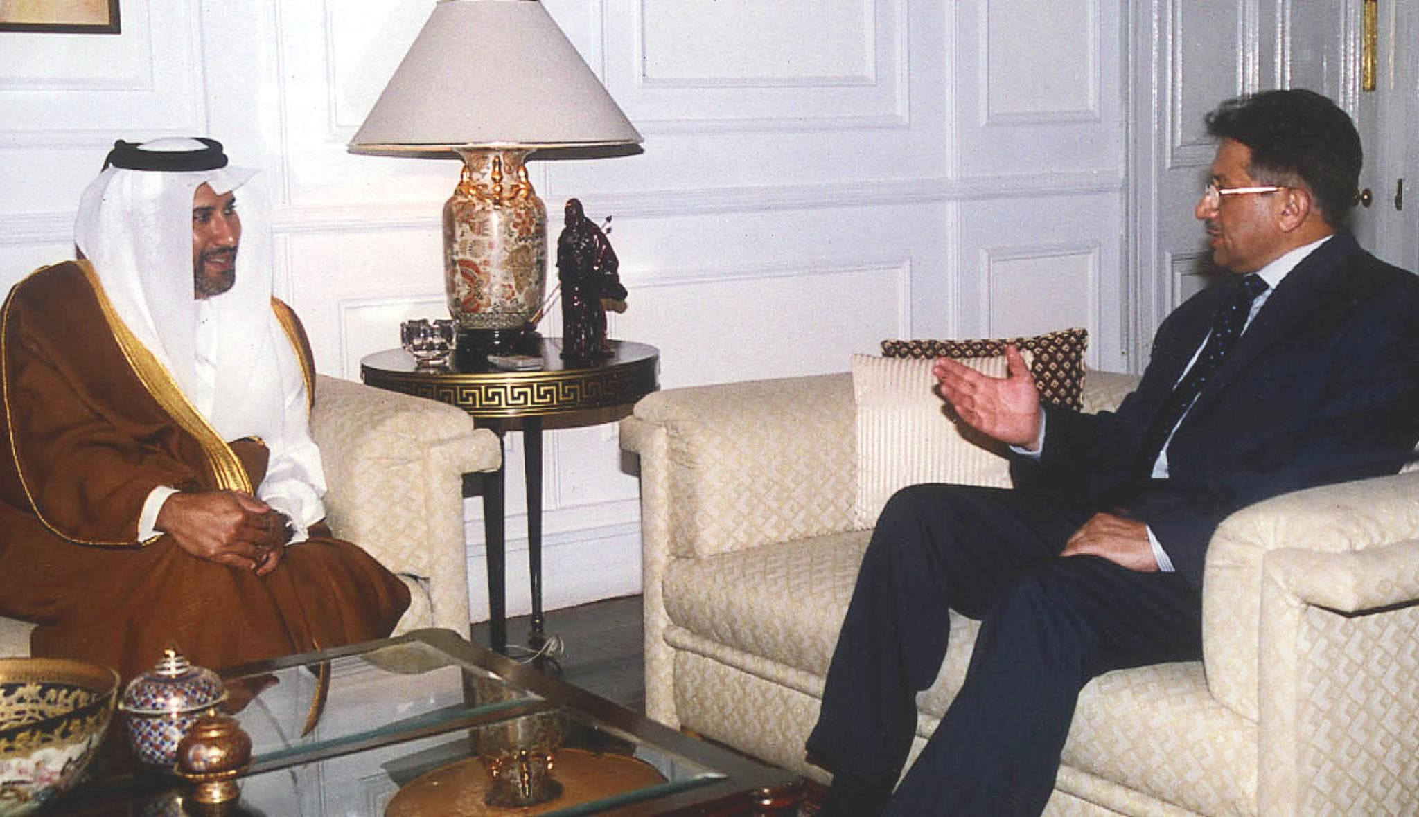 Qatar Foreign Minister Sheikh Hamad Bin Jassim Bin Jabbor Al Thani (L) meets Pakistani President General Pervez Musharraf at army house Rawlpindi on 27 December 2002. (AFP)