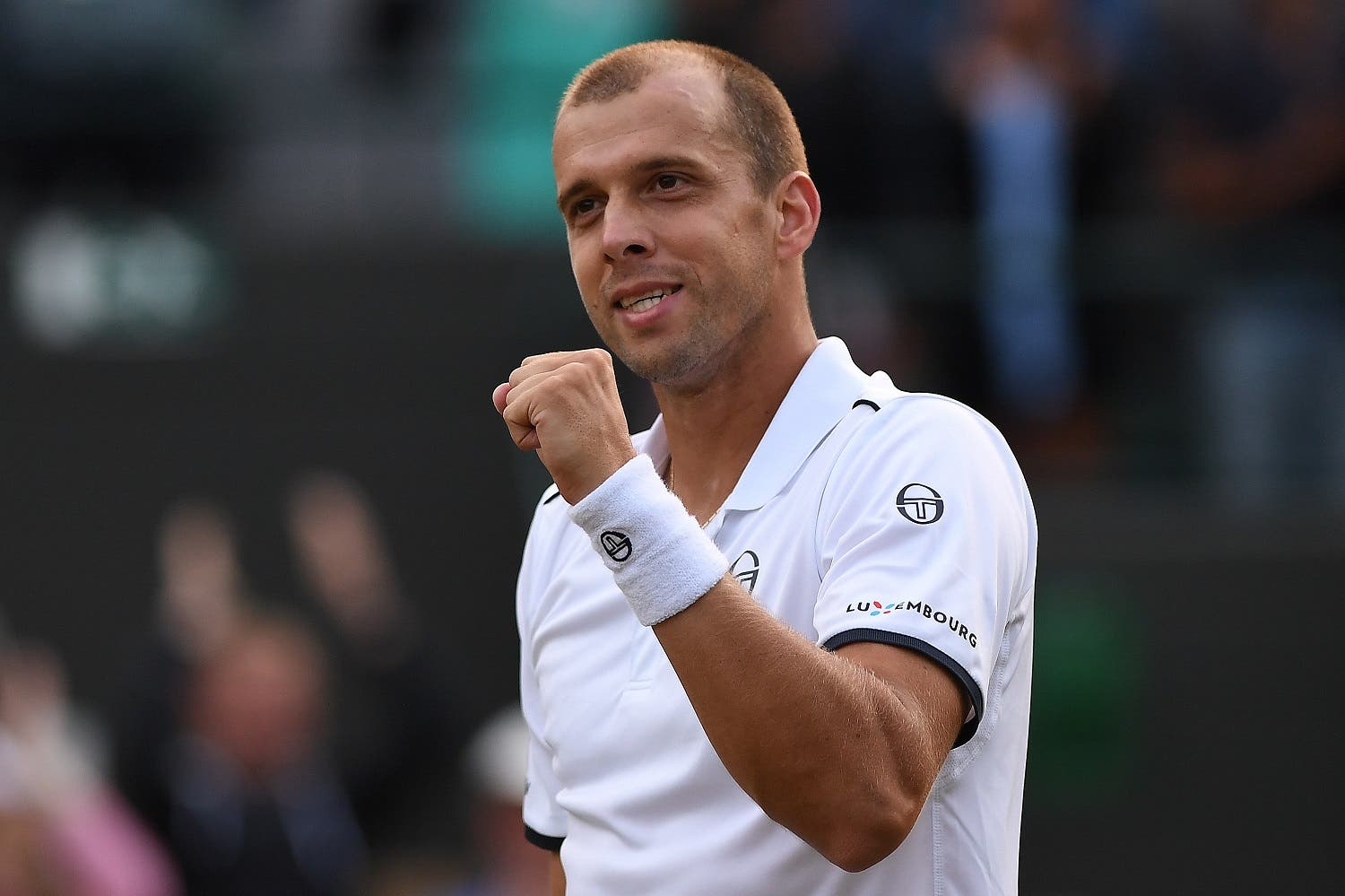 Luxembourg's Gilles Muller reacts after winning against Spain's Rafael Nadal during their men's singles fourth round match on the seventh day of the 2017 Wimbledon Championships at The All England Lawn Tennis Club in Wimbledon, southwest London, on July 10, 2017. Muller won the match 6-3, 6-4, 3-6, 4-6, 15-13. (AFP)