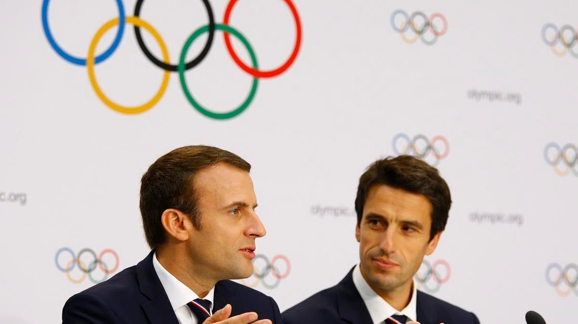 Emmanuel Macron and Tony Estanguet attend the 2024 Olympic Games' press conference after the briefing, in Lausanne, Switzerland. (Reuters)