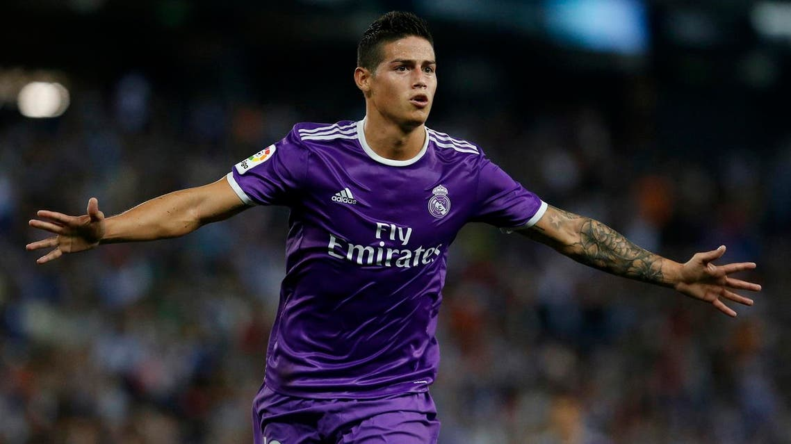 (FILES) This file photo taken on September 18, 2016 shows Real Madrid's Colombian midfielder James Rodriguez celebrating after scoring during the Spanish league football match RCD Espanyol vs Real Madrid CF at the Cornella-El Prat stadium in Cornella de Llobregat. Real Madrid's Colombian midfielder James Rodriguez will be loaned to Bayern Munich for two years, the two football clubs announced on July 11, 2017. According to the website of the German champion, the loan contract contains a call option. (AP)