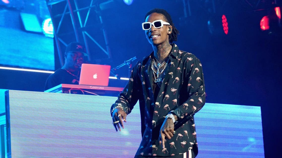 LOS ANGELES, CA - JUNE 22: Recording artist Wiz Khalifa performs onstage at night one of the 2017 BET Experience STAPLES Center Concert, sponsored by Hulu, at Staples Center on June 22, 2017 in Los Angeles, California. Bennett Raglin/Getty Images for BET/AFP