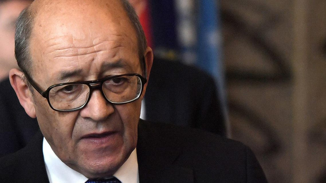 French Foreign Affairs Minister Jean-Yves Le Drian looks on as he leaves following a (AFP)