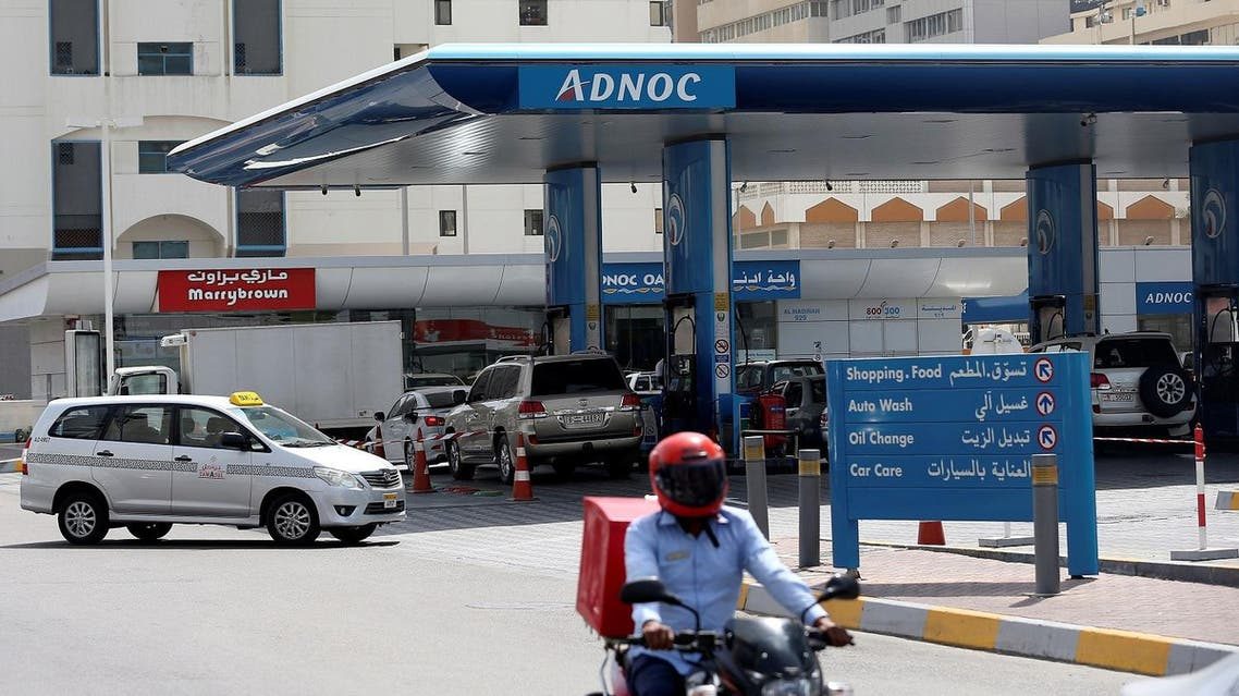 A man rides a motorcycle near an ADNOC petrol station in Abu Dhabi, United Arab Emirates July 10, 2017. REUTERS/Stringer