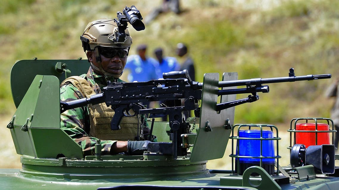 A member of kenya's security forces sits inside an armoured personal carrier during the commissioning of 500 police vehicles at Nairobi's Uhuru Park on January 16, 2017. AFP