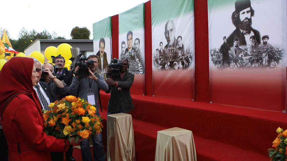Maryam Rajavi holds flowers as she pays tribute during a gathering in Auvers-sur-Oise, near Paris, September 29, 2012. (Reuters)