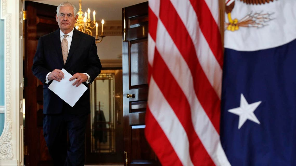 Tillerson walks to speaks at a news conference about Qatar at the State Department in Washington, Friday June 9, 2017. (AP)