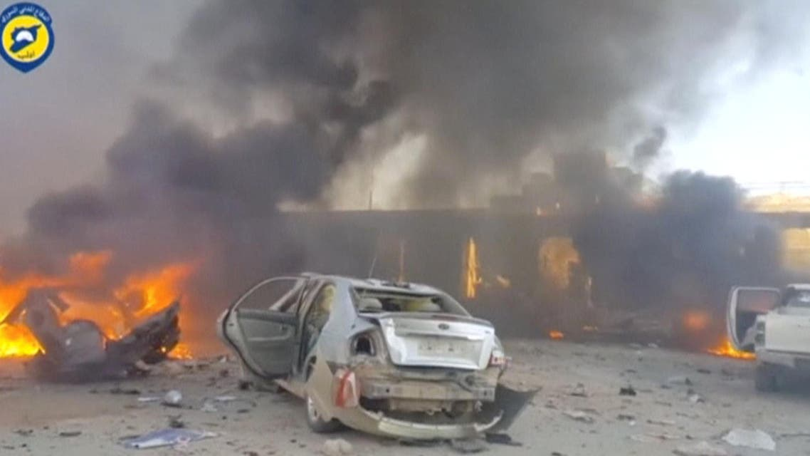 A still image taken from a video uploaded by White Helmets on June 24, 2017, shows vehicles on fire at the site of a car bomb, said to be in the town of al-Dana, in Syria's rebel-held Idlib province. reuters