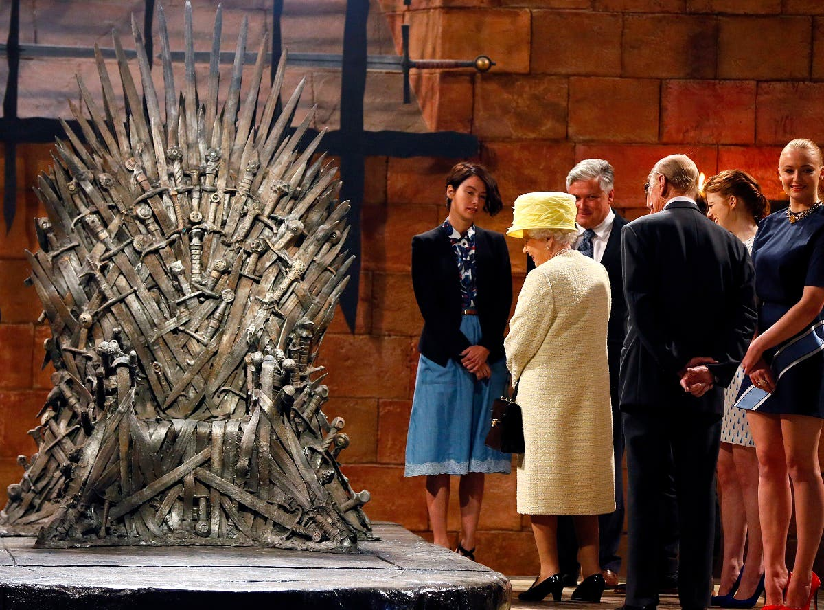 Britain's Queen Elizabeth looks at the Iron Throne as she meets members of the cast on the set of the television series Game of Thrones in the Titanic Quarter of Belfast in 2014. (Reuters)