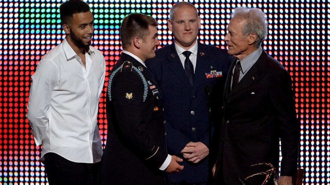 This file photo taken on June 4, 2016, shows (L-R) Anthony Sadler and Spencer Stone accepting the Hero Award from Clint Eastwood in California. (AFP)