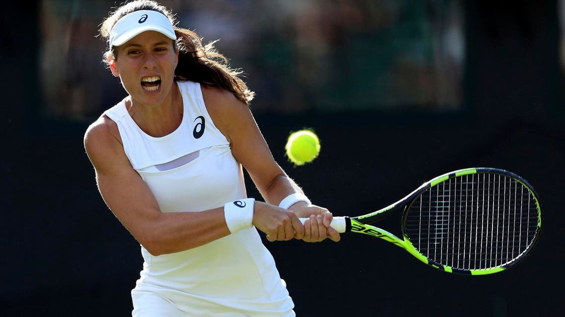 Johanna Konta returns a ball to Taiwan's Su-Wei Hsieh during their Women's Singles Match on day one at the Wimbledon Tennis Championships in London on July 3, 2017. (AP)