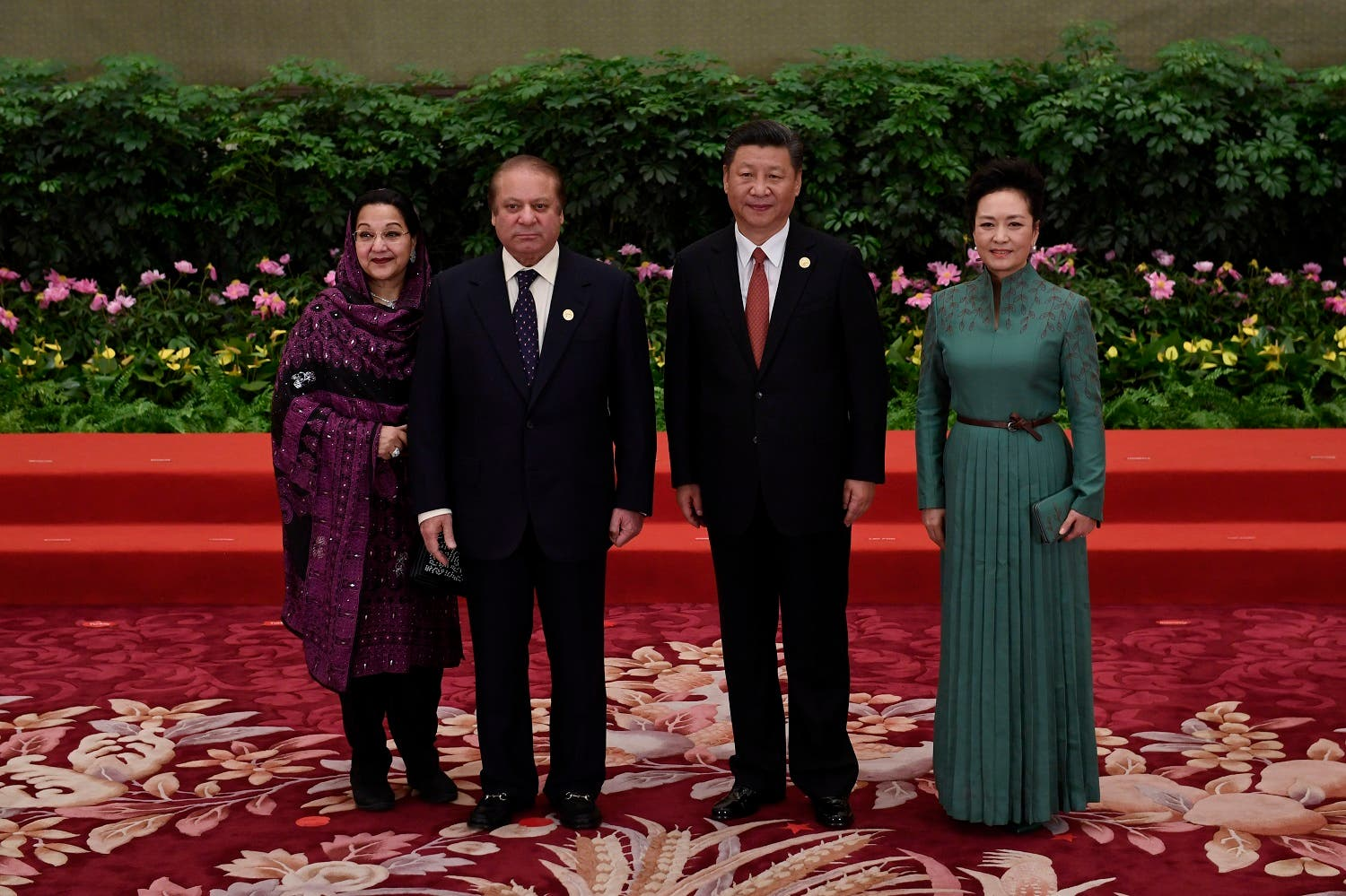 Pakistan's Prime Minister Nawaz Sharif and his wife Kalsoom Nawaz Sharif pose with Chinese President Xi Jinping and his wife Peng Liyuan (R) during a welcome ceremony for leaders attending the Belt and Road Forum, in Beijing's Great Hall of the People on May 14, 2017. (AFP)