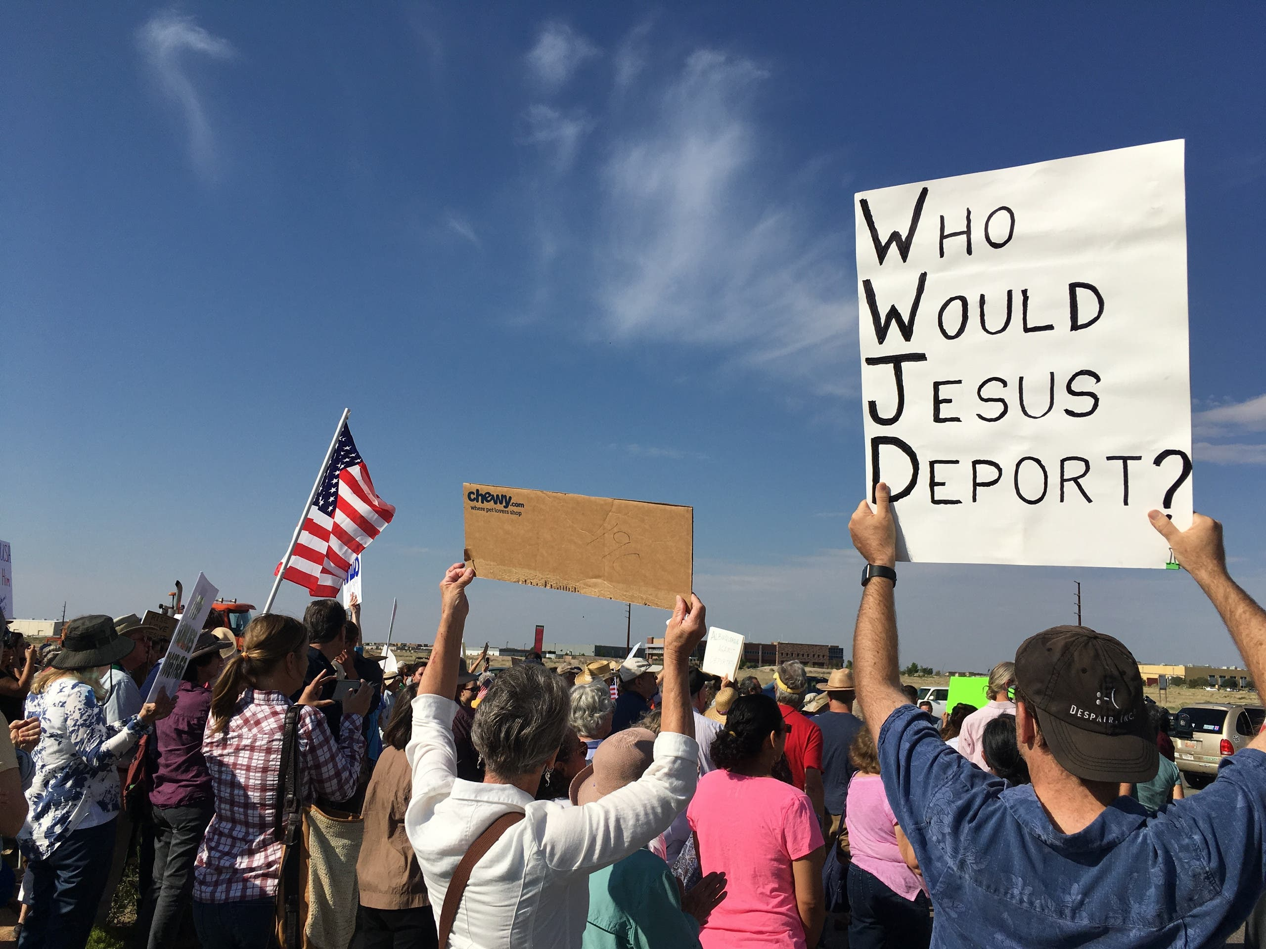 Around 300 supporters demonstrated outside the Immigration and Customs Enforcement offices in Albuquerque, N.M., in support of Iraqi refugee Kadhim Al-bumohammed on Monday, June 26, 2017.AP