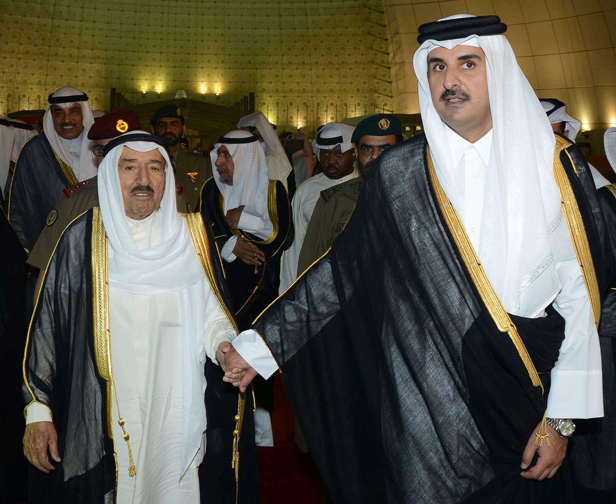 In this June 7, 2017 file photo released by Kuwait News Agency, KUNA, Kuwait's Emir Sheikh Sabah Al Ahmad Al Sabah, left, holds the hand of Qatar's Emir Sheikh Tamim bin Hamad Al Thani in Doha, Qatar. (AP)