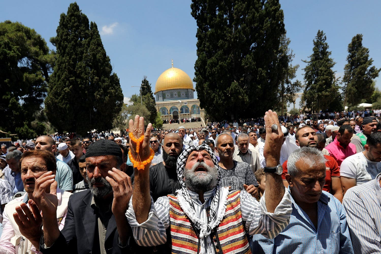 Muslim men pray on the last Friday of Ramadan in front of the Dome of the Rock in Jerusalem's Old City on June 23, 2017. (Reuters)