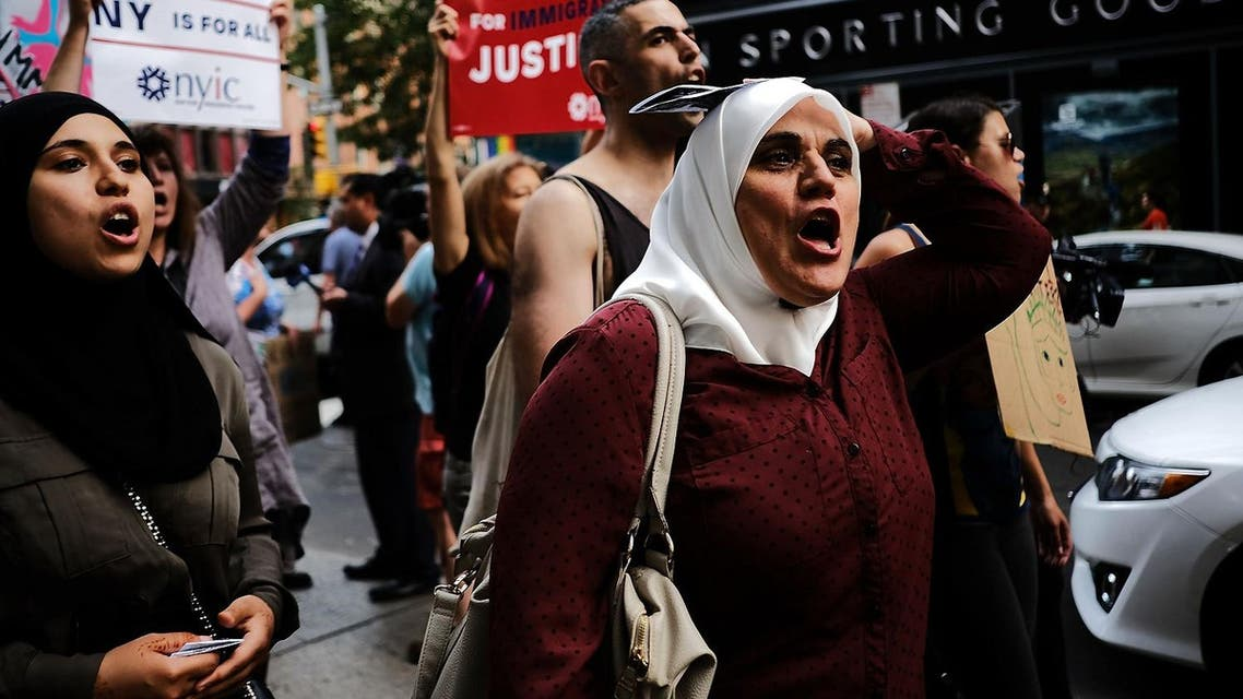 Recent Immigrants join activists for an evening protest in Manhattan hours before a revised version of President Donald Trump's travel ban that was approved by the Supreme Court is to take effect on June 29, 2017 in New York City. (AFP)