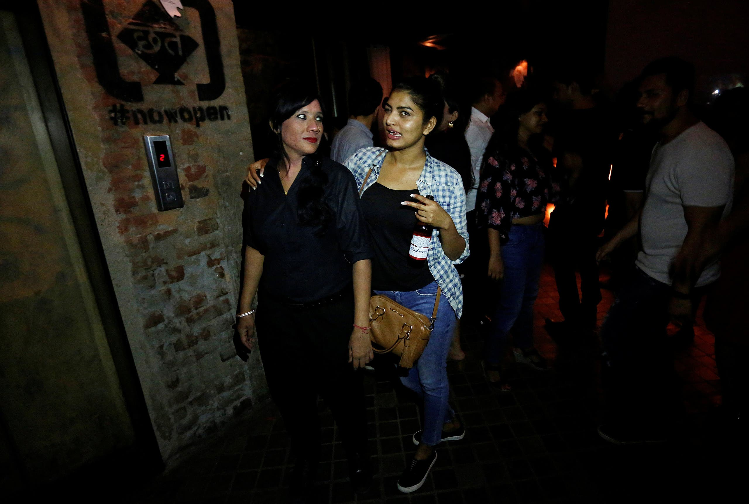 A girl poses for the camera with bouncer Mehrunnisha Shokat Ali (L) at the club Social in New Delhi, India, June 23, 2017.reuters