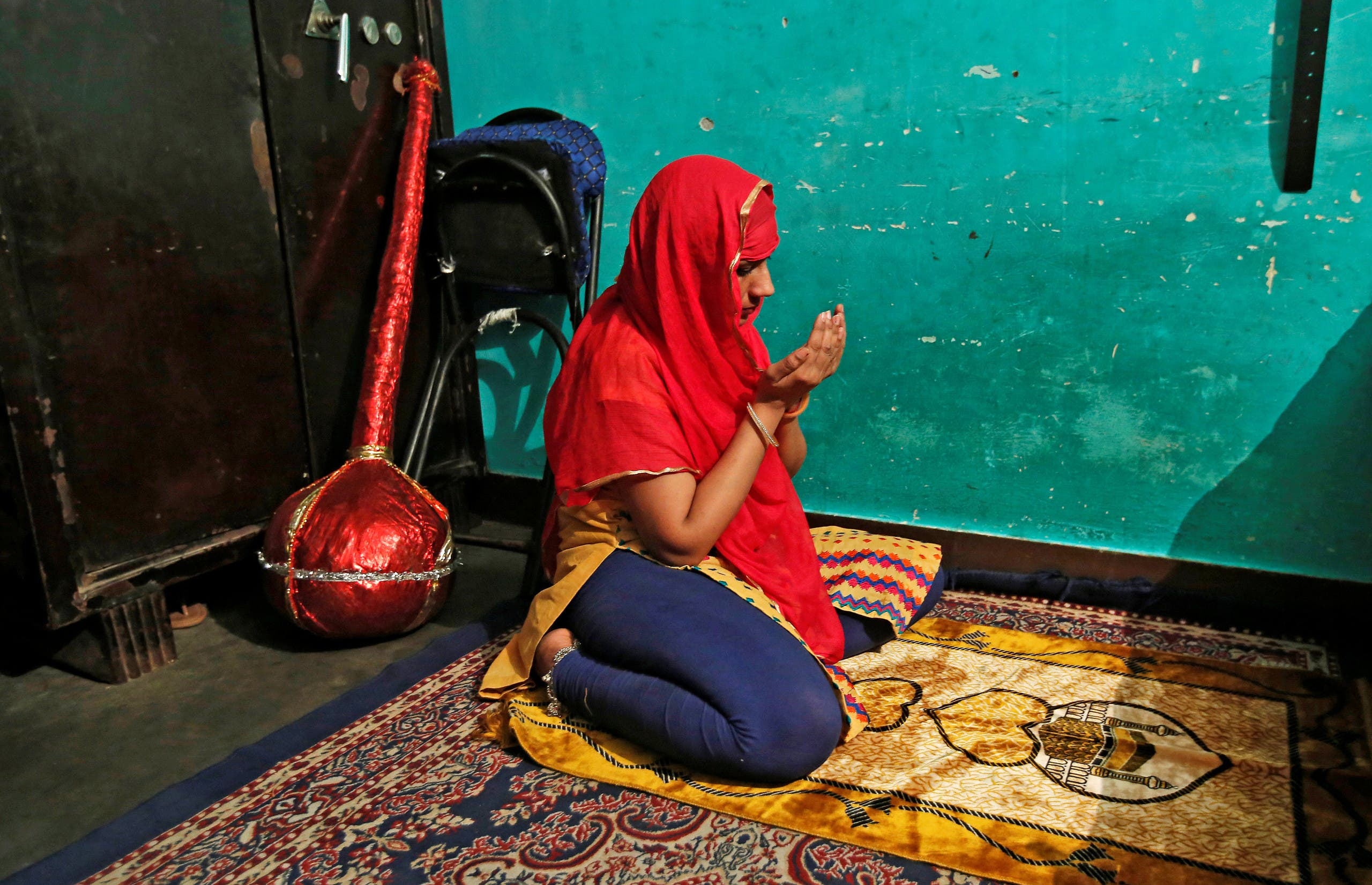 Bouncer Mehrunnisha Shokat Ali offers her evening prayer during holy month of Ramadan at her house in New Delhi, India, May 31, 2017. reuters