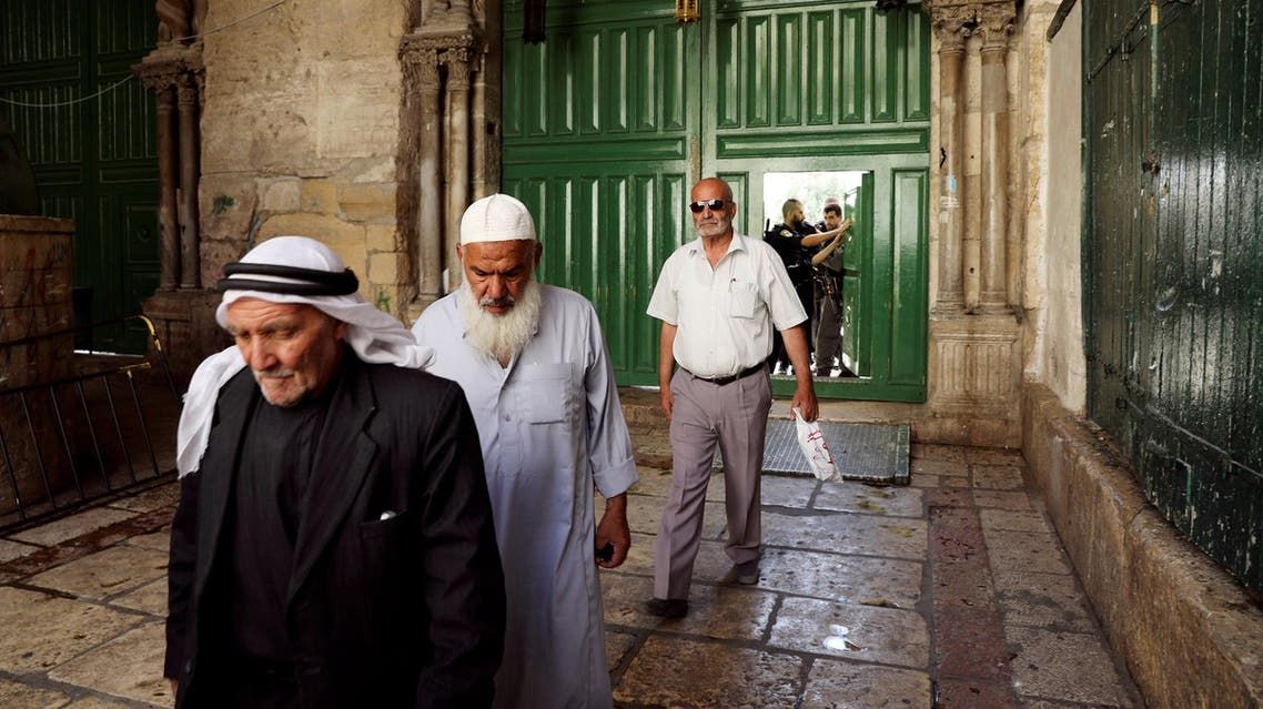 Muslim men walk out from the Noble Sanctuary compound in Jerusalem's Old City on Friday, July 14, 2017. (Reuters)