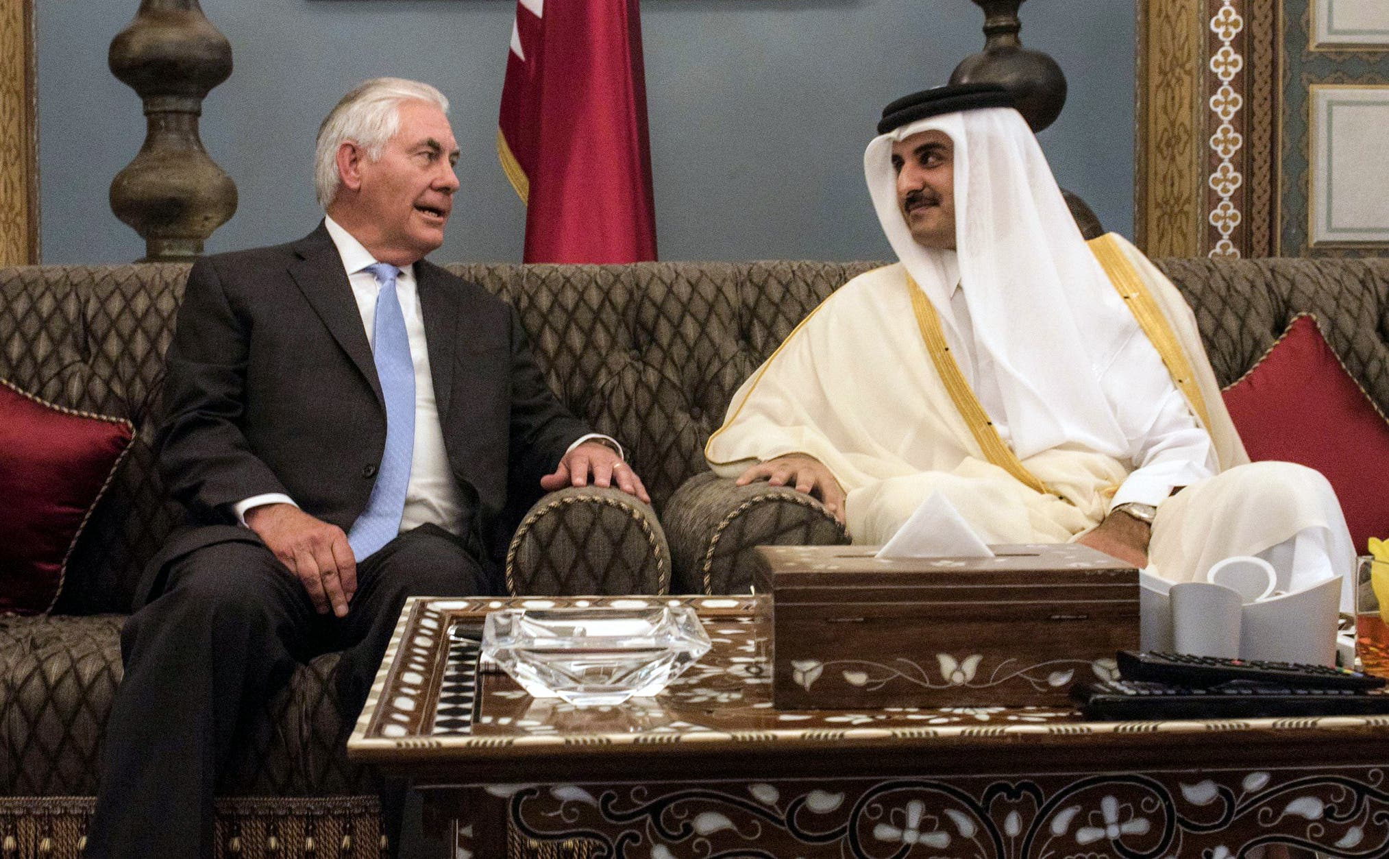 A handout picture provided by the US Embassy in Doha's Official Twitter account on July 11, 2017 shows US Secretary of State Rex Tillerson (L) meeting with Qatar's Emir Sheikh Tamim bin Hamad Al-Thani at the Prince's Sea Palace residence in the capital Doha. (AFP)