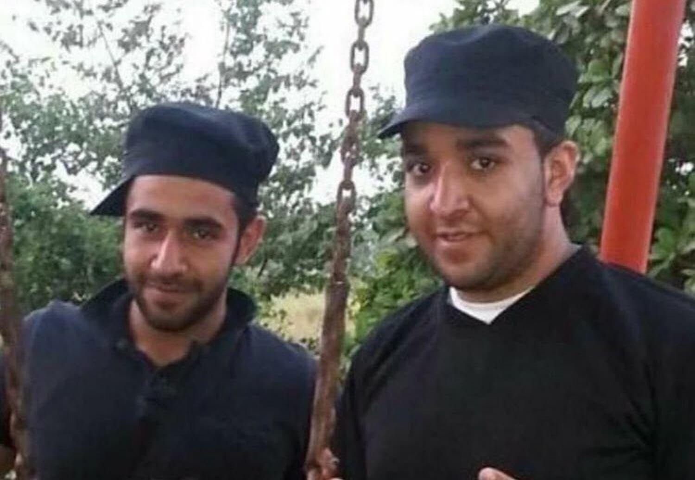 Hassan al-Abdullah with his uncle Salman al-Faraj who escaped during the farm house raid. (Supplied)