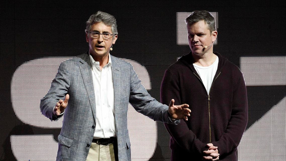 """Alexander Payne, left, co-writer/director of the upcoming film """"Downsizing,"""" addresses the audience as cast member Matt Damon looks on during the Paramount Pictures presentation at CinemaCon 2017 at Caesars Palace on Tuesday, March 28, 2017, in Las Vegas. (Photo by Chris Pizzello/Invision/AP)"""