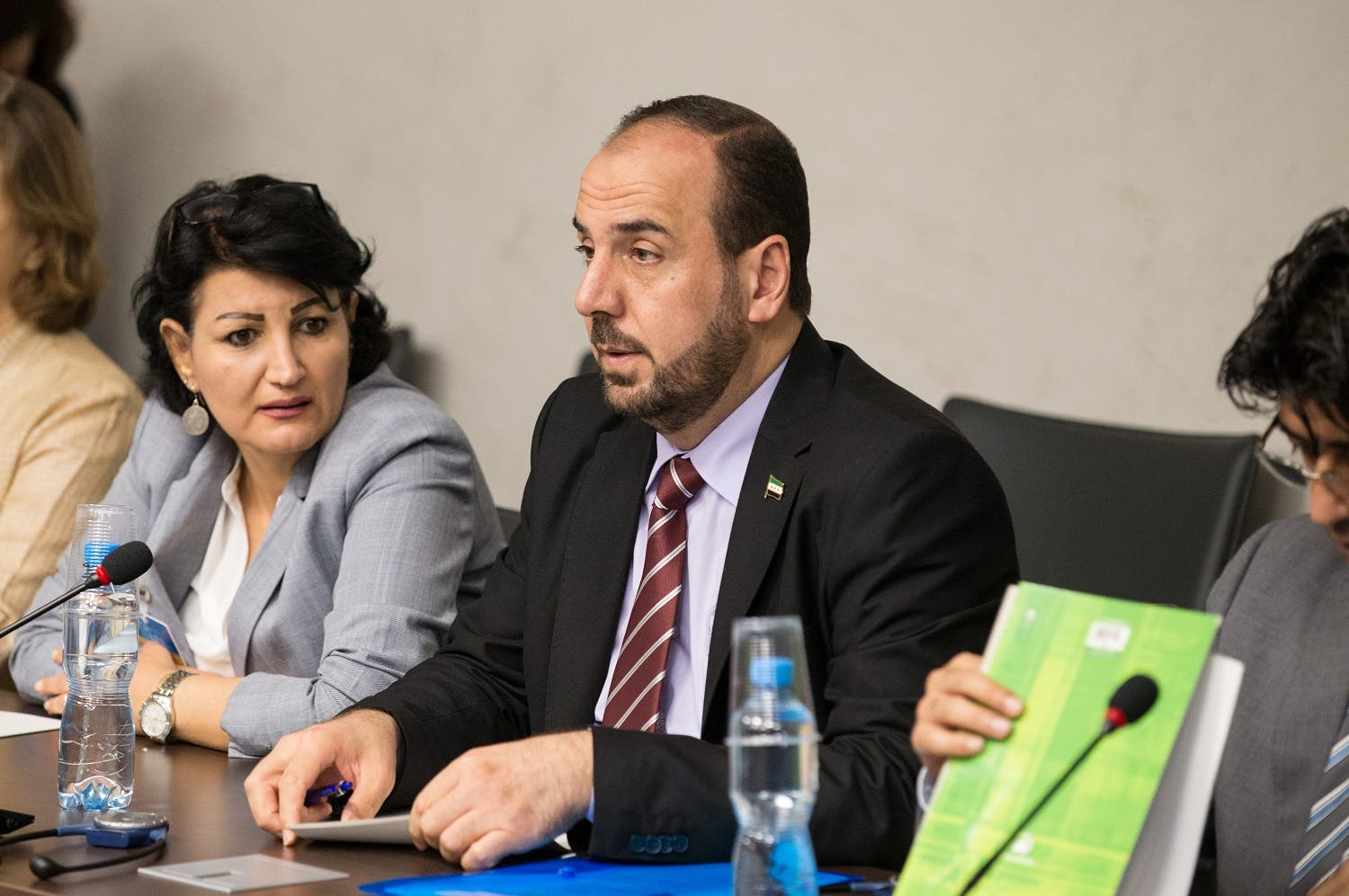 Syria's main opposition High Negotiations Committee (HNC) leader Nasr al-Hariri (C) attends a new round of negotiation with UN Special Envoy of the Secretary-General for Syria Staffan de Mistura. (Reuters)