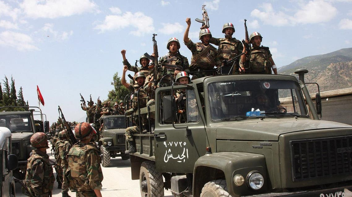 """FILE -- In this June 10, 2011, file photo, taken during a government-organised visit for media, Syrian army soldiers standing on their military trucks shout slogans in support of Syrian President Bashar Assad, as they enter a village near the town of Jisr al-Shughour, north of Damascus, Syria. Syrian President Bashar Assad's regime has a host of options if the United States launches military strikes against it. It could directly retaliate with rockets or unleash allies like Hezbollah against Western targets. Or it could do nothing -- and score propaganda points as a victim of """"U.S. aggression."""" The regime's choice, analysts say, will likely depend on the magnitude of the U.S. military action -- the bigger and more sustained the strikes, the more likely the government in Damascus will feel compelled to respond. (AP Photo/Bassem Tellawi, File)"""