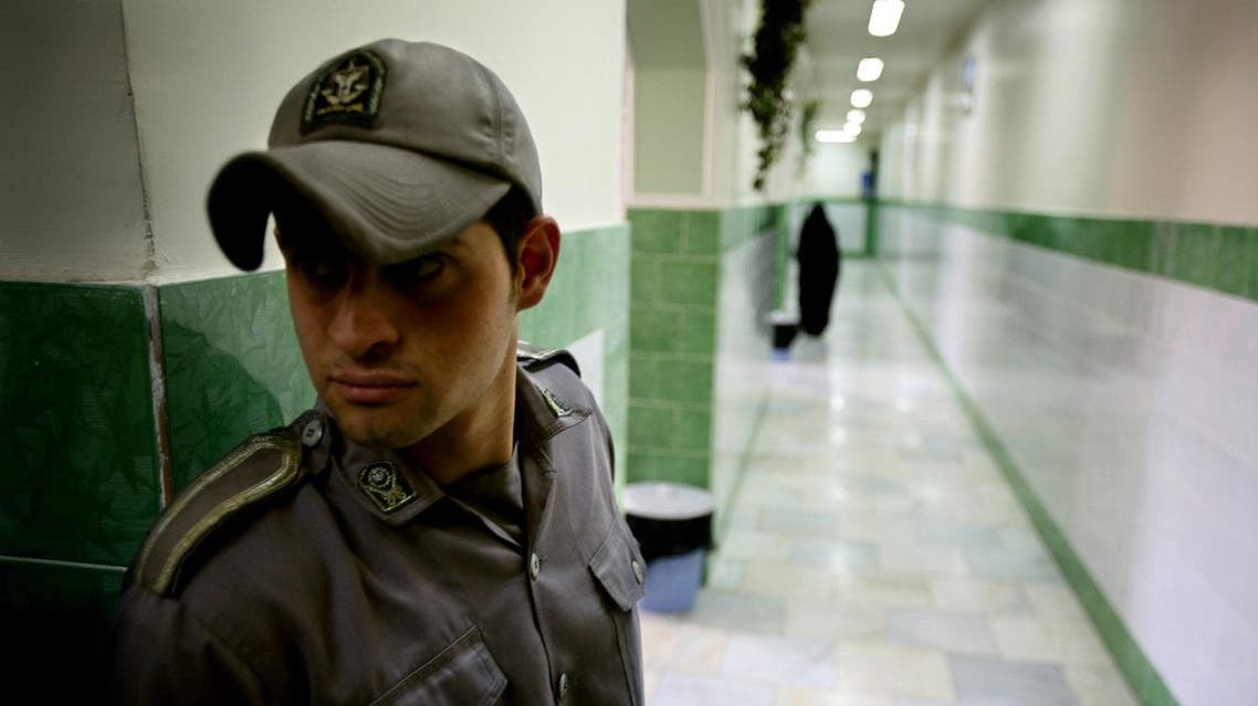 A prison guard stands along a corridor in Tehran's Evin prison June 13, 2006. Iranian police detained 70 people at a demonstration in favour of women's rights, the judiciary said on Tuesday, adding it was ready to review reports that the police had beaten some demonstrators. REUTERS/Morteza Nikoubazl (IRAN)