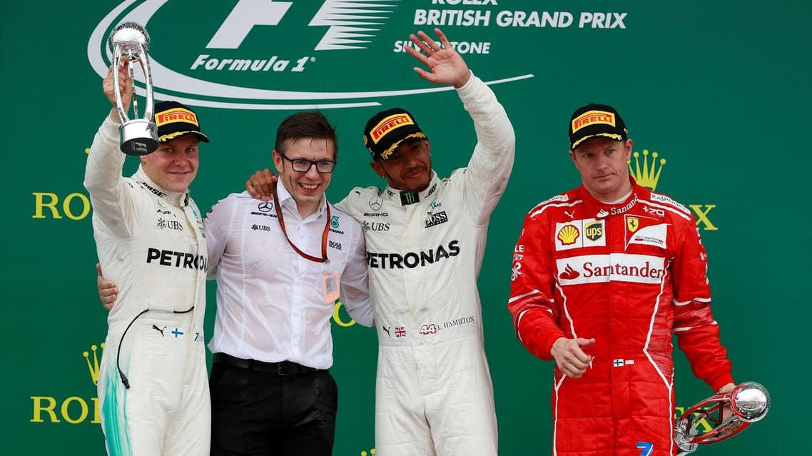 Mercedes' Lewis Hamilton celebrates his British Grand Prix 2017 win with team mate Valtteri Bottas and Ferrari's Kimi Raikkonen, on July 16, 2017. (Reuters)