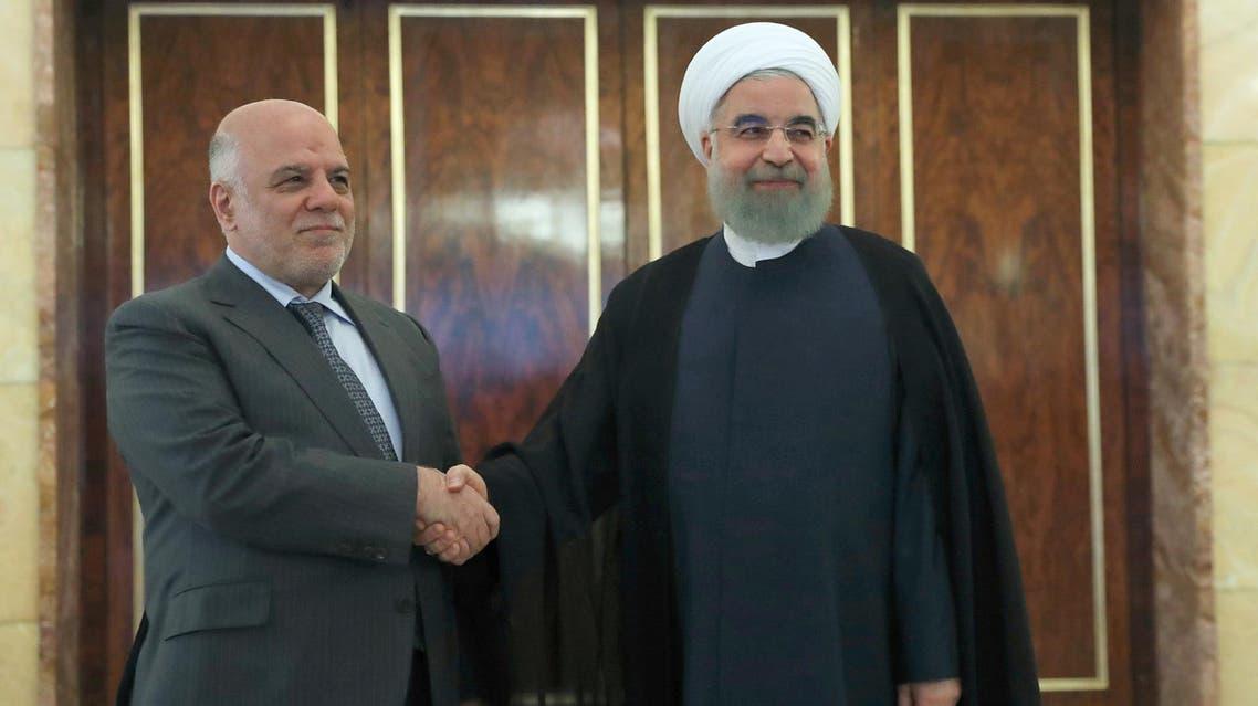 Iranian President Hassan Rouhani with Haidar al-Abadi in Tehran on June 20 2017. (AFP)