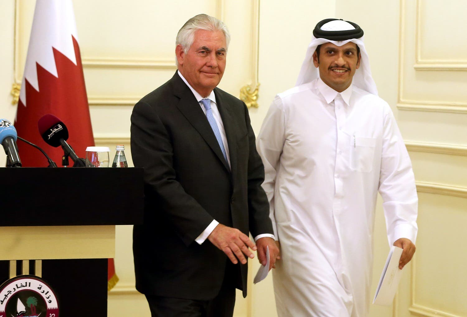 Rex Tillerson and Sheikh Mohammed bin Abdulrahman Al-Thani leave the stage following a press conference in Doha, on July 11, 2017. (AFP)