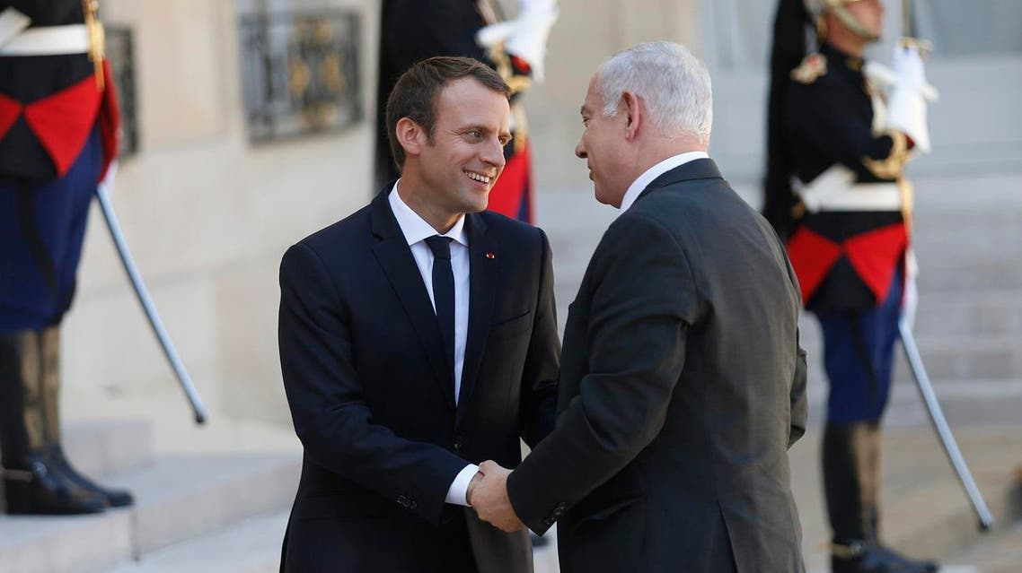 French President Emmanuel Macron (L) welcomes Israeli Prime Minister Benjamin Netanyahu (R) at the Elysee Palace, in Paris, on July 16, 2017 ahead of their meeting. (AFP)